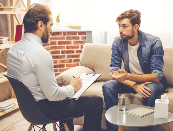 therapist interviewing a man