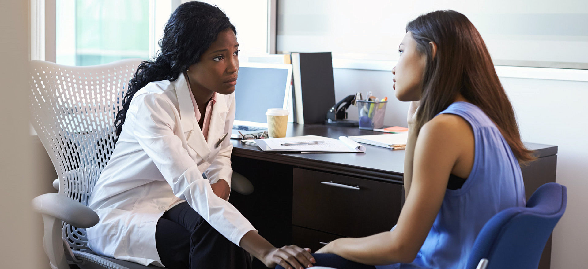 therapist comforting a woman