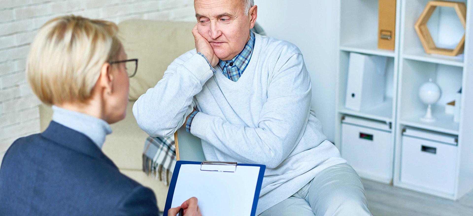 therapist interviewing an elderly man