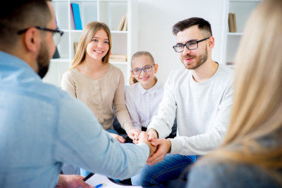 Family of three talking with psychologist
